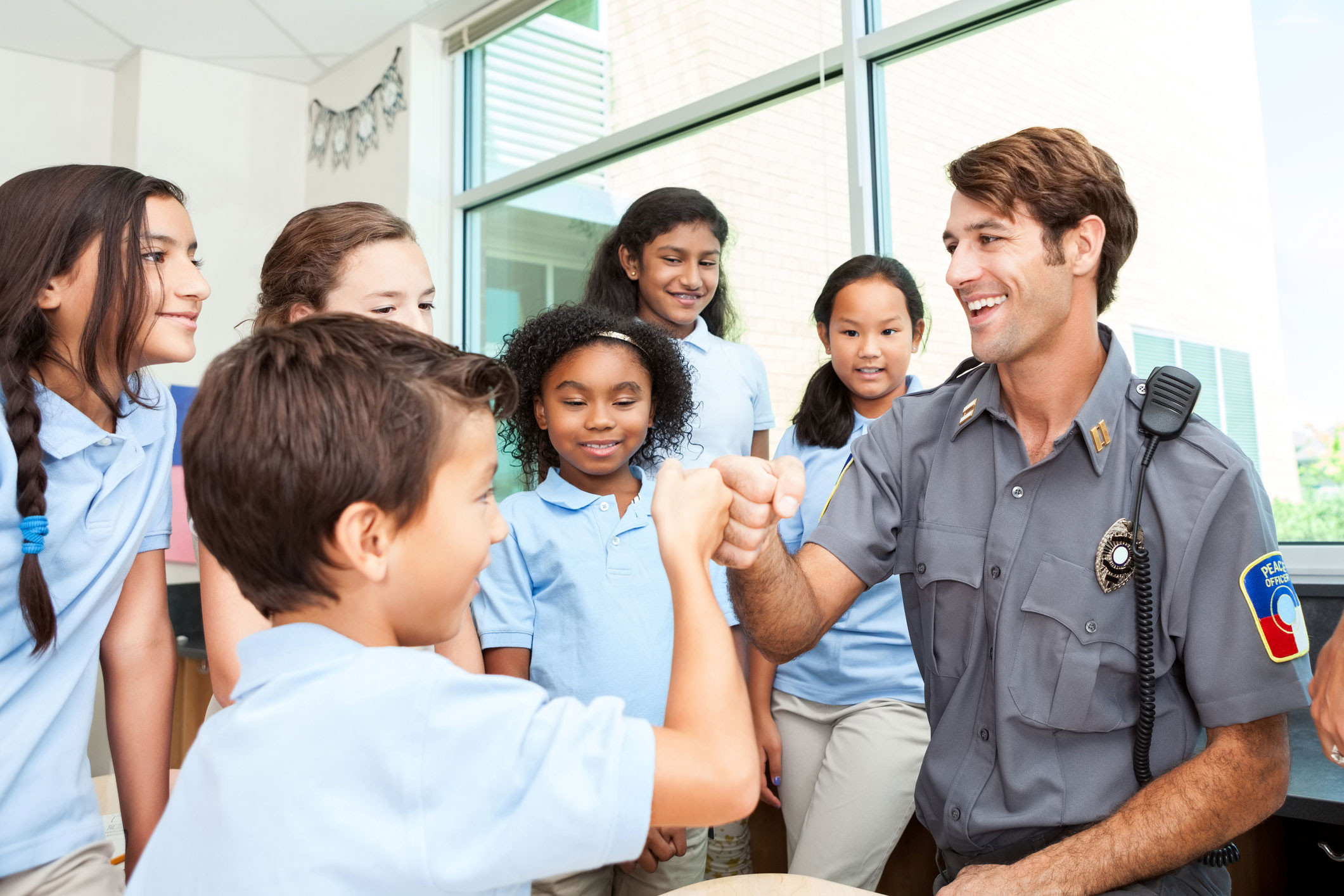 Police Officer hanging out with school kids.